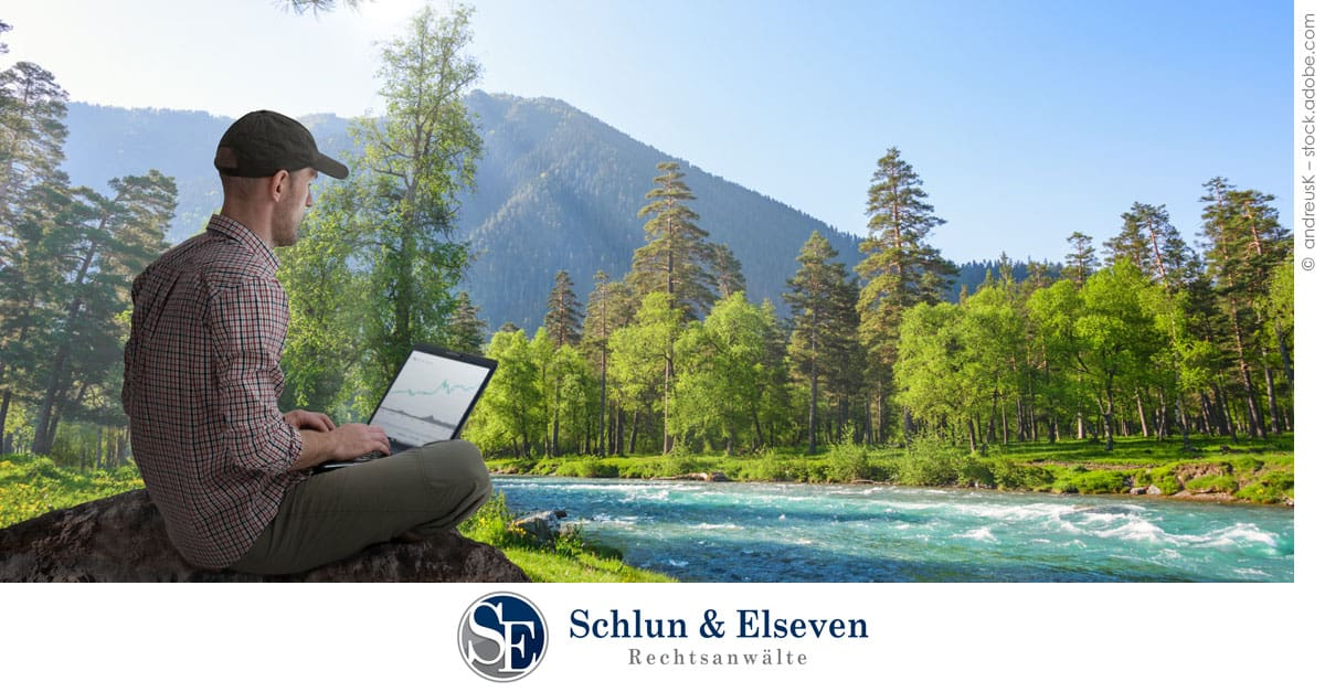 Man sitting in front of river. Digital Nomads in Germany